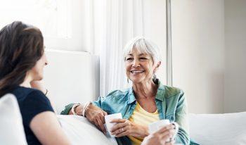 Happy women having tea together.