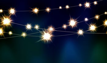 Strings of twinkle lights with blue and green wash lighting.
