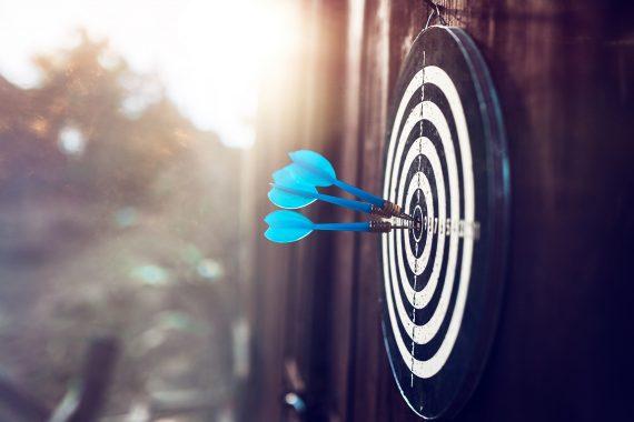 Blue darts on an outdoor target