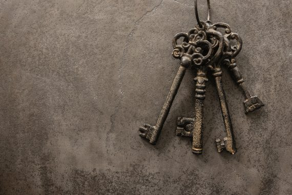 Wrought iron keys on a stone surface