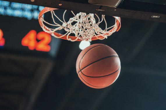 basket ball through basket with scoreboard reading 42