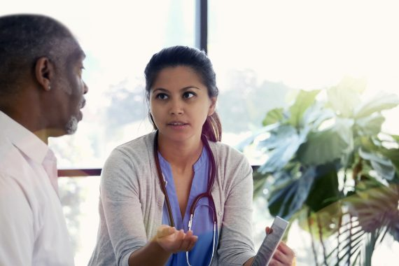 Clinician talking to a business professional