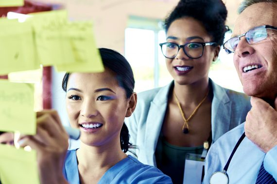 Medical professionals using sticky notes for brainstorming