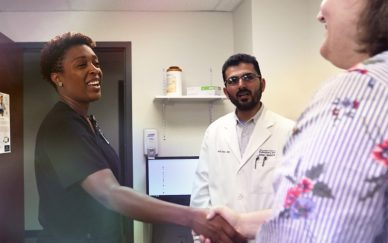 Medical professional shaking hands with a patient