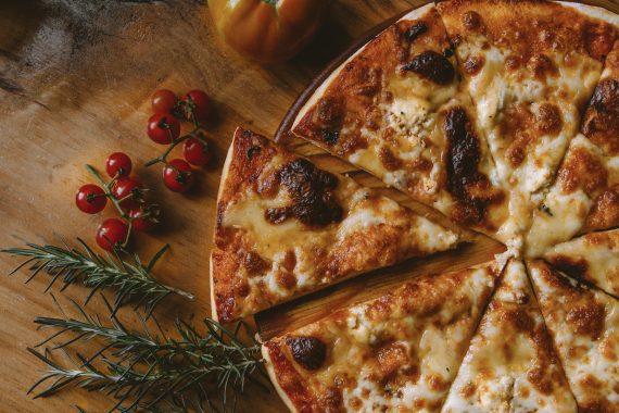 Pizza pie sliced to serve